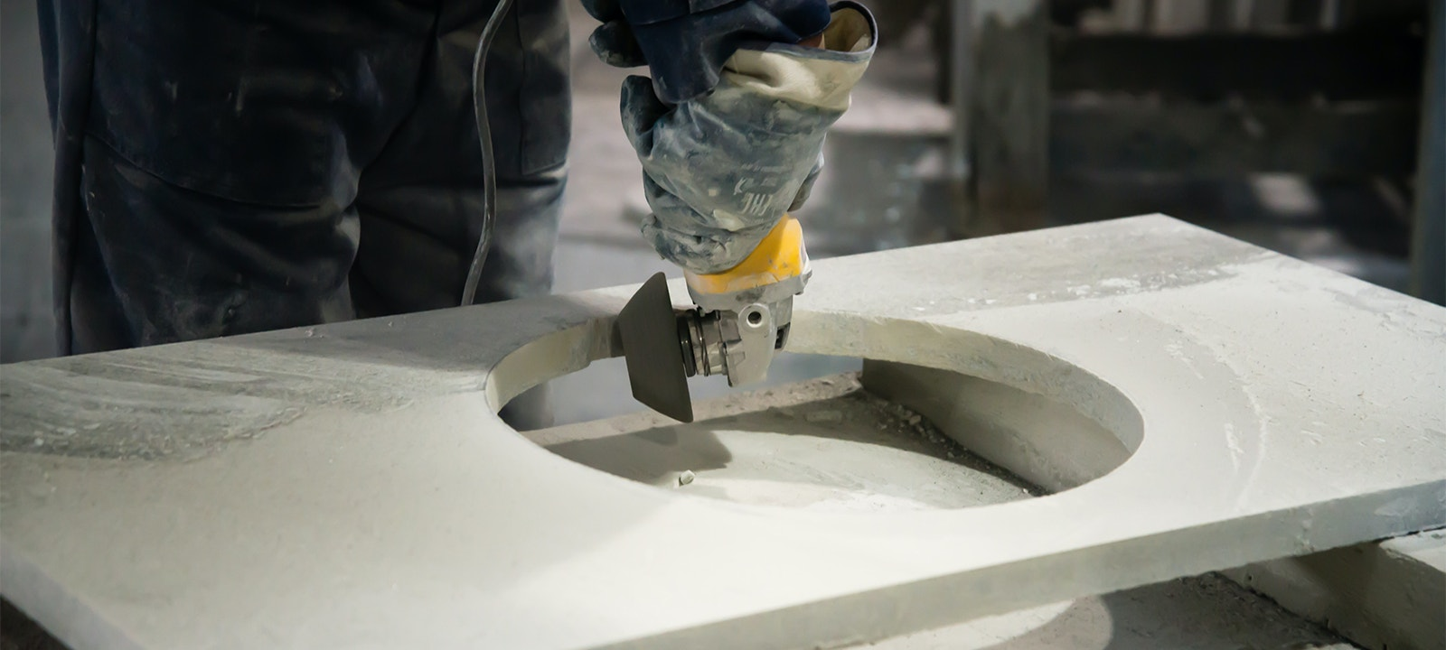 Man cutting stone bench silica resized