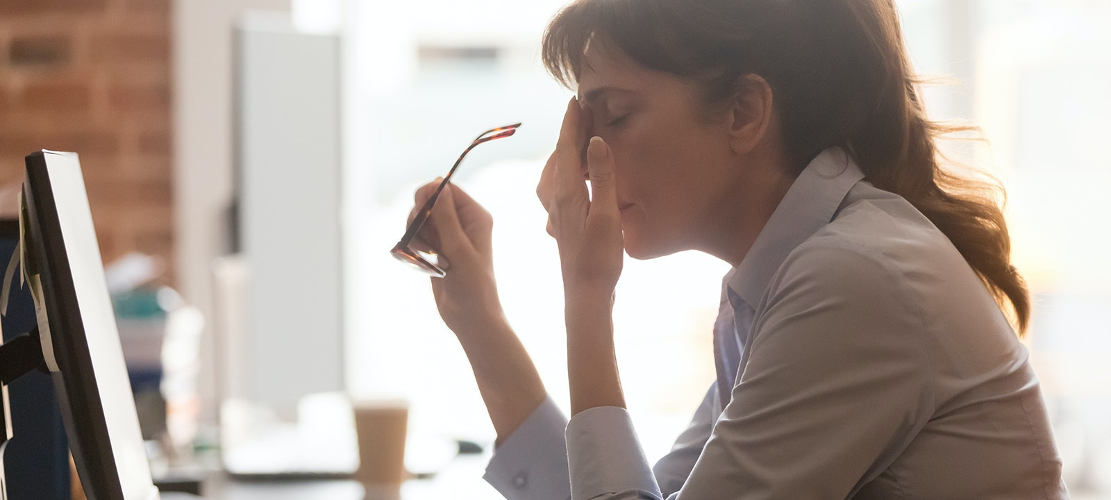Woman tired at desk resized